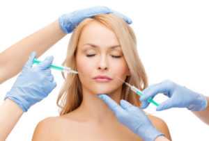 photodune-7064054-woman-face-and-beautician-hands-with-syringes-m